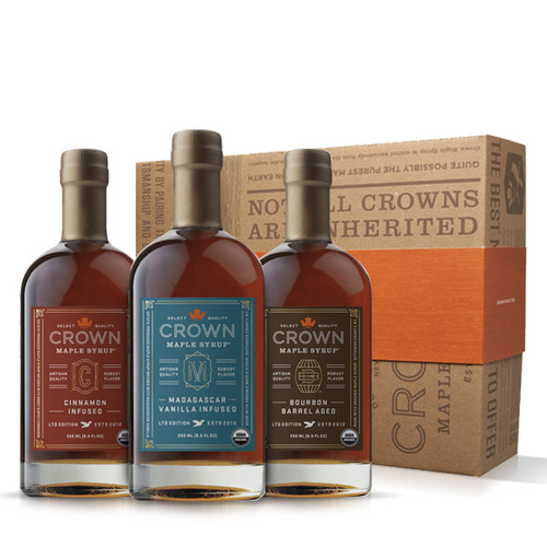 Make an uncommon impression with this distinctive Crown Maple Infused Trio Collection presented in an elegant Royal Treatment box with your choice of our signature classic orange band or HAPPY HOLIDAYS band.  This organic maple syrup sample collection explodes with flavor excitement allowing you to explore the versatility of our infused maple syrups. Collection contains one 250ML (8.5 FL OZ) bottle each of Bourbon Barrel Aged organic maple syrup (may contain up to 2% alcohol), Madagascar Vanilla Infused organic maple syrup, and Cinnamon Infused organic maple syrup.  Discover the versatility of our infused, organic maple syrups to add layers of distinctive flavors and artisan quality to elevate your favorite recipes, beverages, and more —healthier sweetener and flavor excitement for coffee & tea; topping for fruits, yogurt, oatmeal, baked goods, desserts, ice cream; marinade and basting glaze; and premium replacement for simple syrup in cocktails, and more.