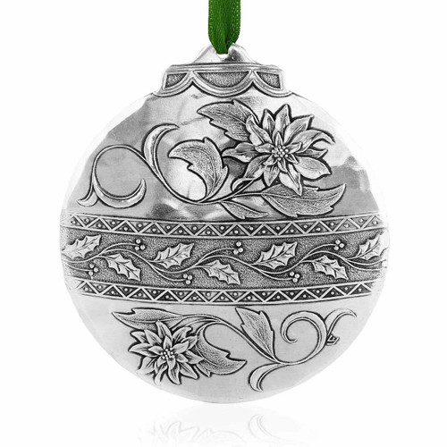 Poinsettia metal Christmas keepsake ornament from Wendell August Forge will be a cherished part of your holiday d??cor for years to come.