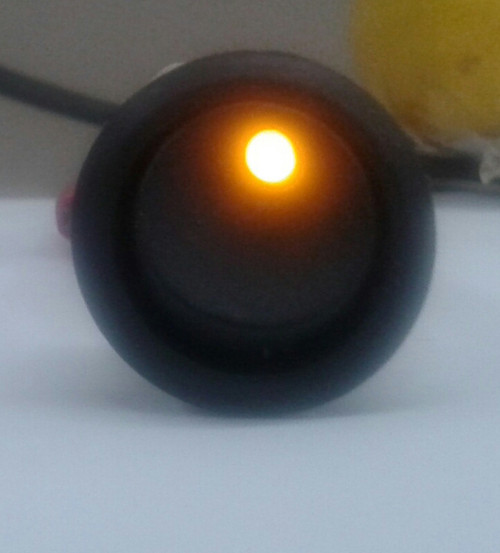 SPRR85/12AD Round Rocker, On-Off, Amber Dot Illumination, Single Pole