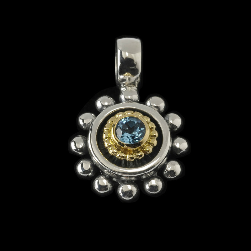 Blue Topaz, Sterling Silver and 18 k Gold Pendant handmade by Bowman Originals, Sarasota, 941-302-9594.