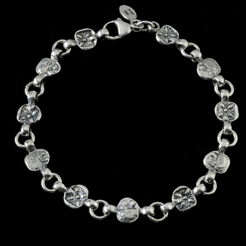 Lion Bracelet, Silver, handmade   Bowman Originals, Sarasota, 941-302-9594.