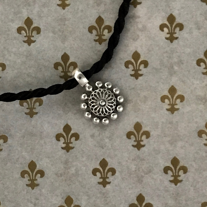 Handmade Sterling Silver Beaded Flower Pendant on Silk Cord by Bowman Originals, Sarasota, 941-302-9594.