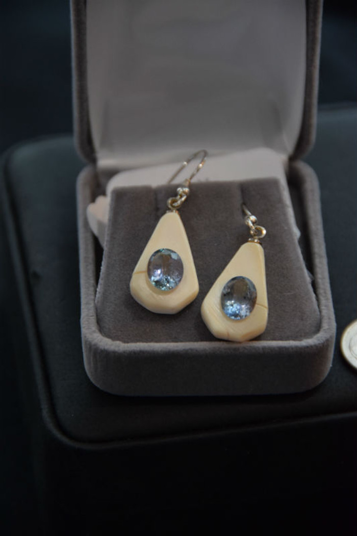 Alaskan Native crafted ivory with a sparkling oval shaped natural Tanzanite as the stunning center stones of this earring set