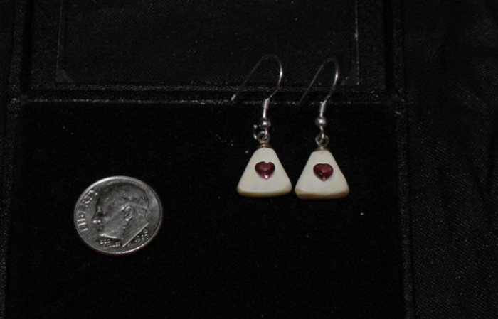 Alaskan Native crafted ivory with a sparkling petite red heart shaped natural Rhodolite as center stones of this earring set