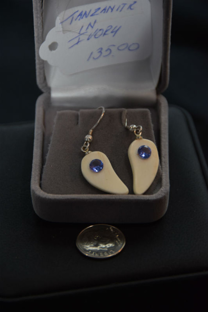 Alaskan Native crafted ivory with a sparkling round shaped natural Tanzanite as center stone of this earring set