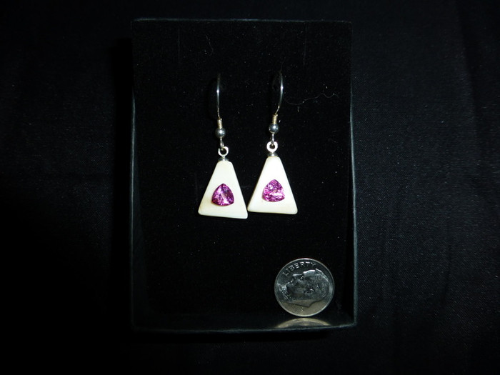 Alaskan Native crafted ivory with featuring natural pink trillion topaz as center gemstones of this unique earring set