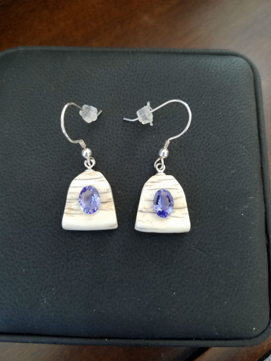 Alaskan Native crafted ivory with oval natural Tanzanite as center stone of earring set