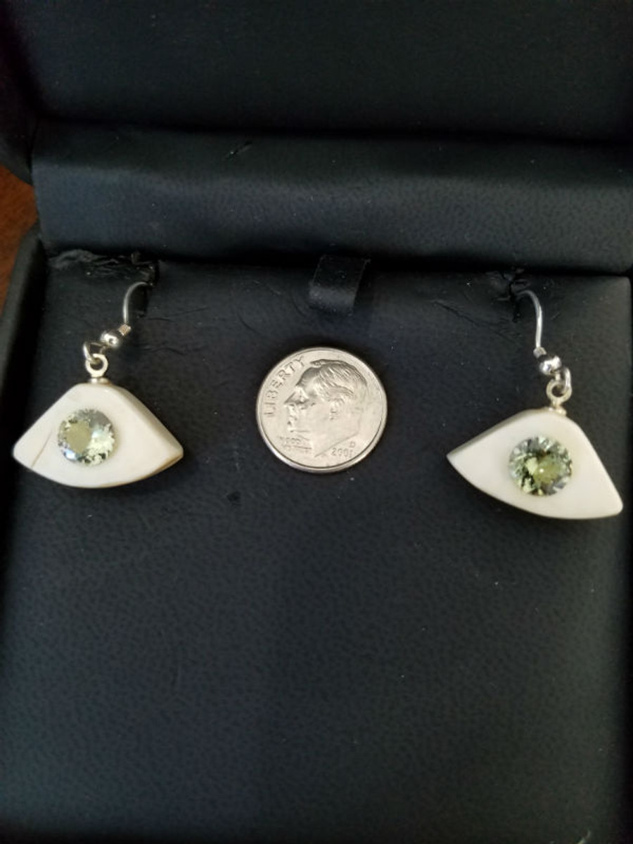 Alaskan Native crafted ivory with round natural Tanzanite as center stone of earring set