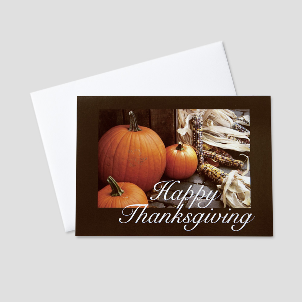 Business Thanksgiving greeting card featuring pumpkins and fall corn on display surrounded by a thick brown border and accompanying Thanksgiving message