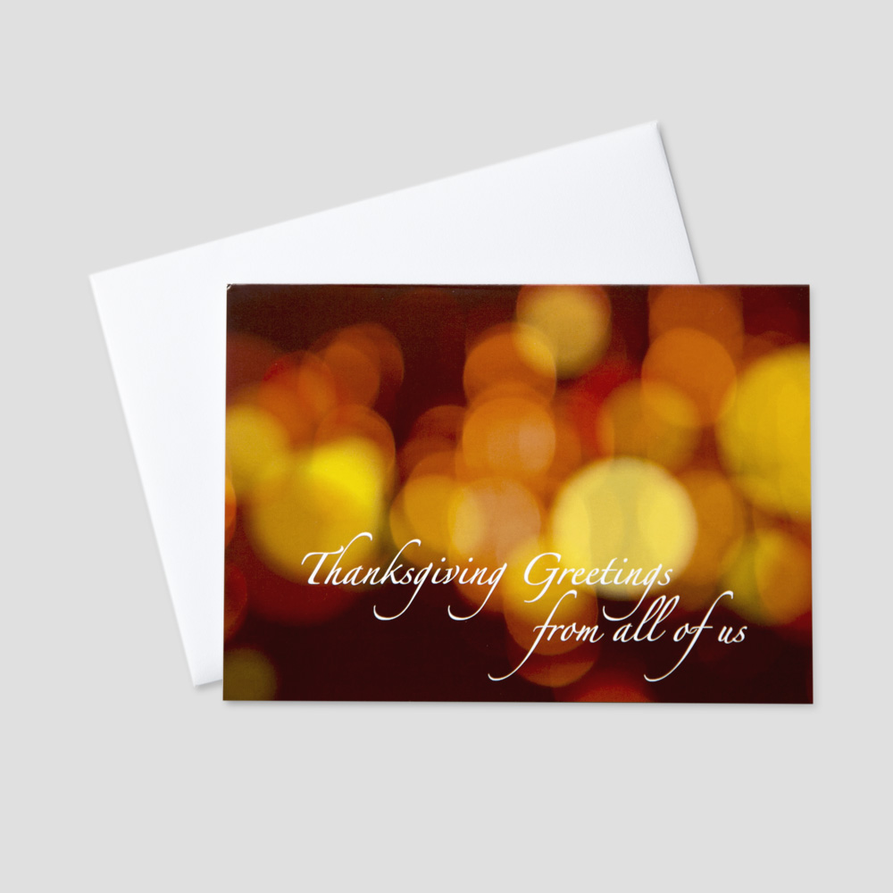 Company Thanksgiving greeting card featuring a background of amber colored light and a Thanksgiving message from all