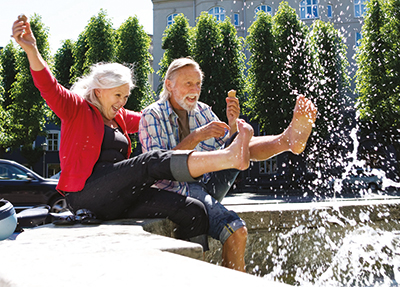 Couple kicking in a fountain