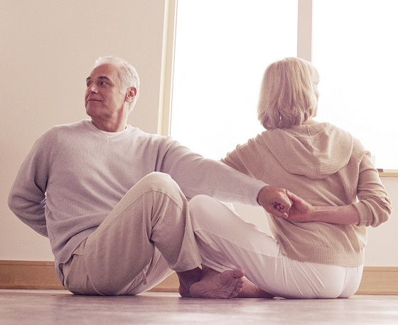 couple doing yoga for sexual health benefits