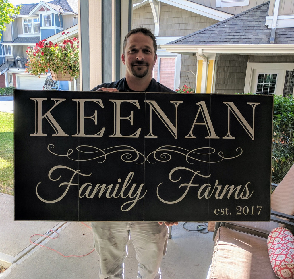 Happy Customer with Rustic Family Sign