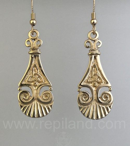 Earrings with trinity knots, scrolls, beads and scallop shell edges.