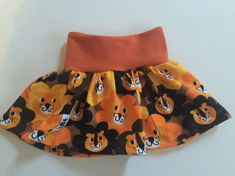 Astrid Skirt in Lion Flower with a burnt orange waistband.