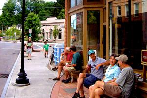 Gimme! Tburg exterior with customers chatting on the benches