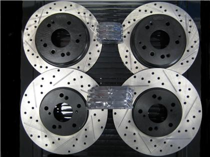 STOPTECH Drilled & Slotted Rotors with STOPTECH Ceramic Pads and XLR8 Stainless Steel Brake Lines - Front and Rear - RDX 07-09