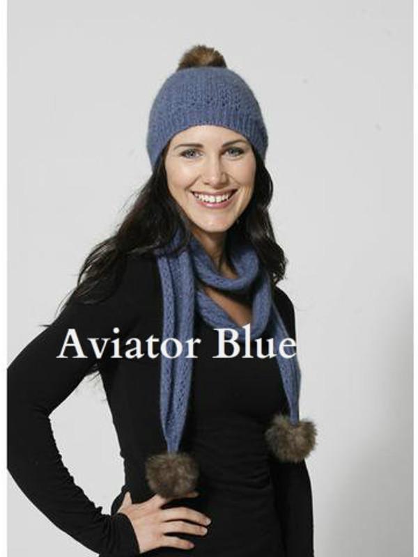 Our beautiful beanie adorned with pure possum fur pom pom in aviator blue.
