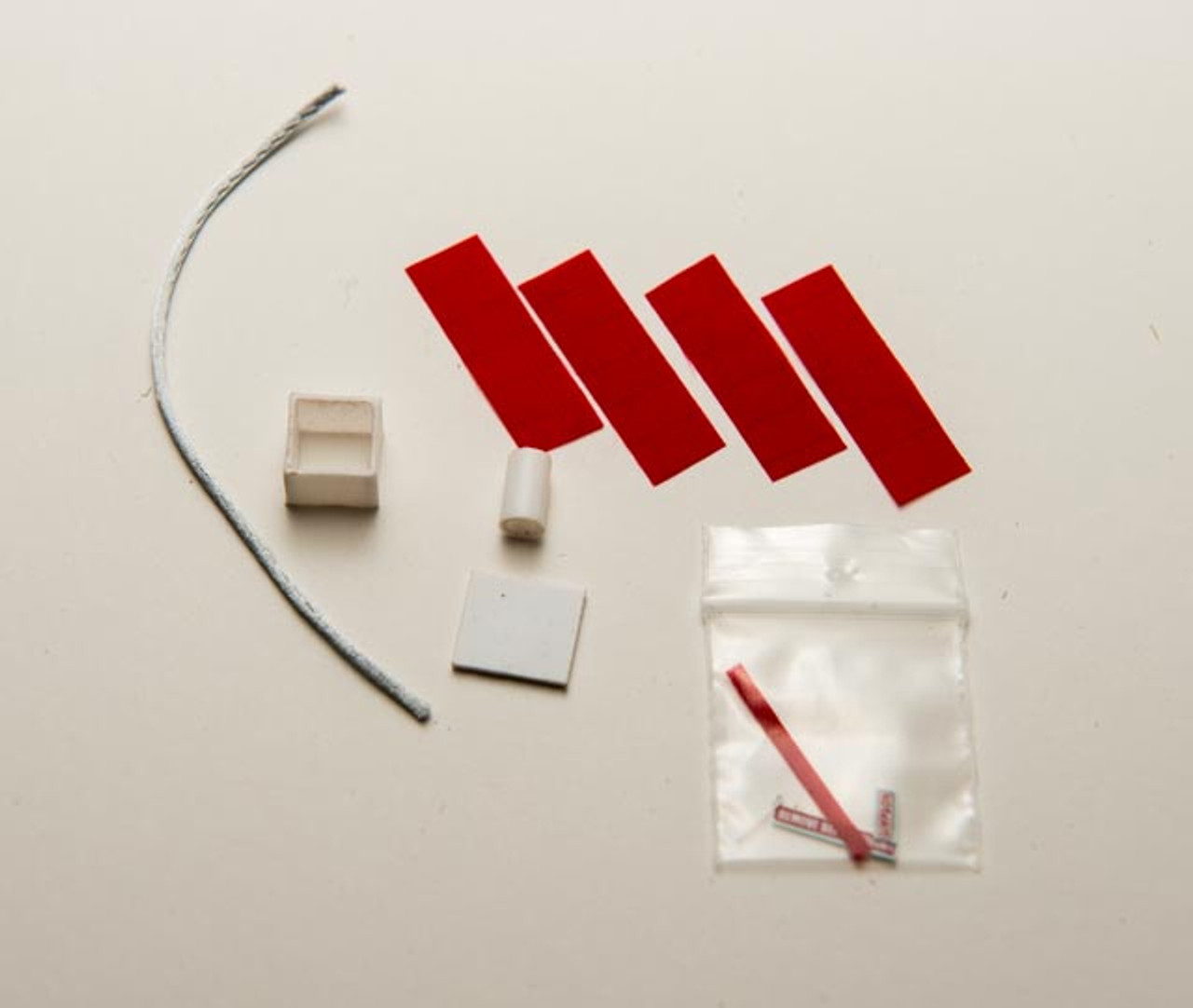 Parts included (red parachute shown)