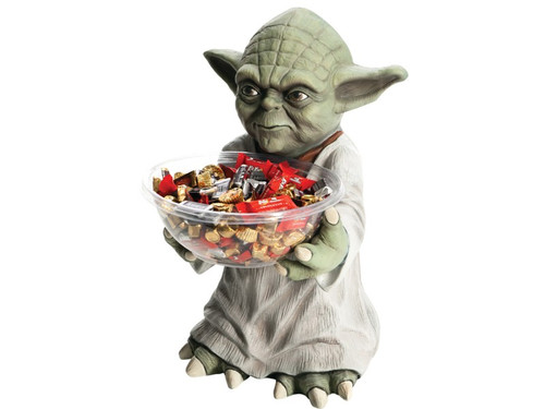 """This mini-character candy holder is great for Halloween parties and trick-or-treaters! Yoda holds a candy bowl for you to fill! The mini-character is crafted from heavy duty foam, light-weight injection molded construction and stands approximately 18"""" tall with a 10"""" square base. The back is flat, designed to stand flush against a wall. Also included is the clear plastic candy bowl that fits in character's hand. Add your own candy!"""