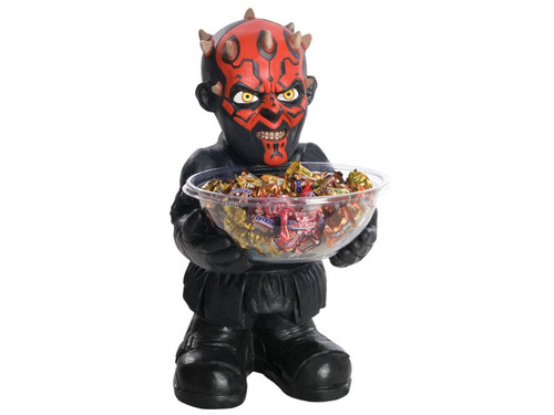 """This mini-character candy holder is great for Halloween parties and trick-or-treaters! Darth Maul holds a candy bowl for you to fill! The mini-character is crafted from heavy duty foam, light-weight injection molded construction and stands approximately 18"""" tall with a 10"""" square base. The back is flat, designed to stand flush against a wall. Also included is the clear plastic candy bowl that fits in character's hand. Add your own candy!"""