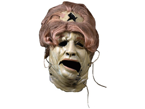 The officially licensed Texas Chainsaw Massacre - Leatherface 1974 Grandma Mask. Sculpted by Connor Deless, this mask is based on promo backlot images and door scene of Leatherface in the 1974 Horror Classic, The Texas Chainsaw Massacre. Every detail of Leatherface is captured in this amazing latex mask. So get yourself the official Leatherface 1974 Grandma Mask, our Leatherface Costume and Sledgehammer and terrorize your neighborhood this Halloween Night!