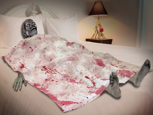 Great concept for haunted house scene. Head, hands, feet, and blood spattered sheet. The head measures 11 inches from top of head to bottom, each foot measures 9 inches from the toes to the heel and 3 inches from left to right. Ankle to bottom of foot is 6 inches. Each hand measures 13 inches from fingers to the stump, and 5 inches from one side of hand to the other.
