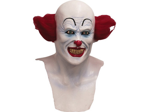 Full over-the-head mask with chest piece features a scary clown with red tuffs of hair on the sides of his bald head. His skin is painted clown white with an eerie blue glow and his face is detailed with black arched eyebrows, a traditional red clown nose and a creepy grin with yellow pointed teeth.