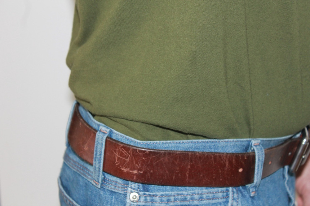 The TRR easily conceals the Glock 43 under a regular size tucked in t-shirt.