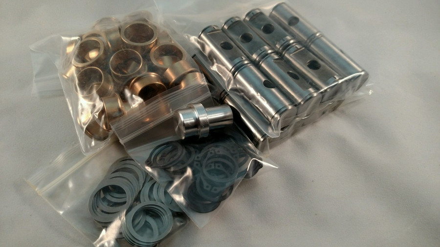 16 Billet toolsteel trunnions , 32 bushings ,32 shim ,32 thrust washers and 1 install tool