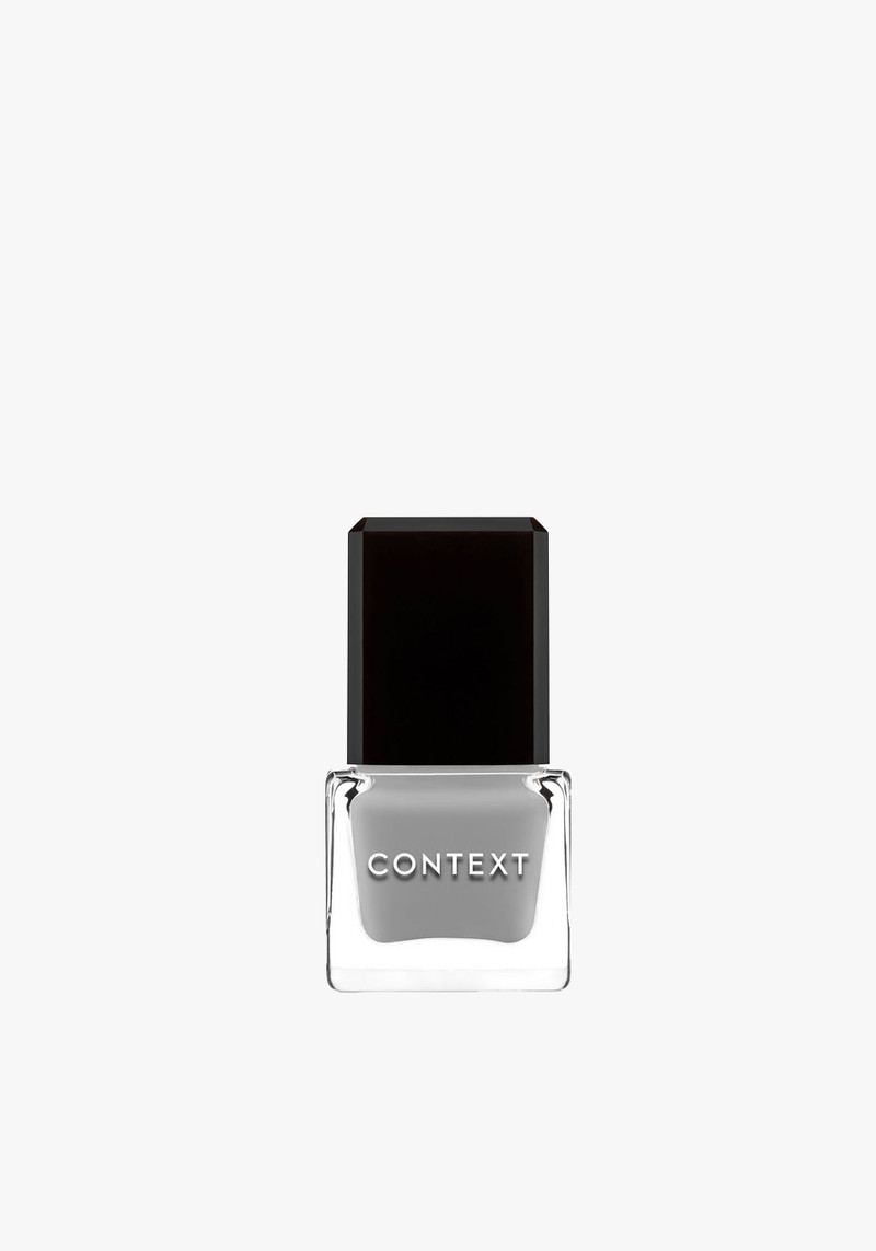context skin pale blue nail polish