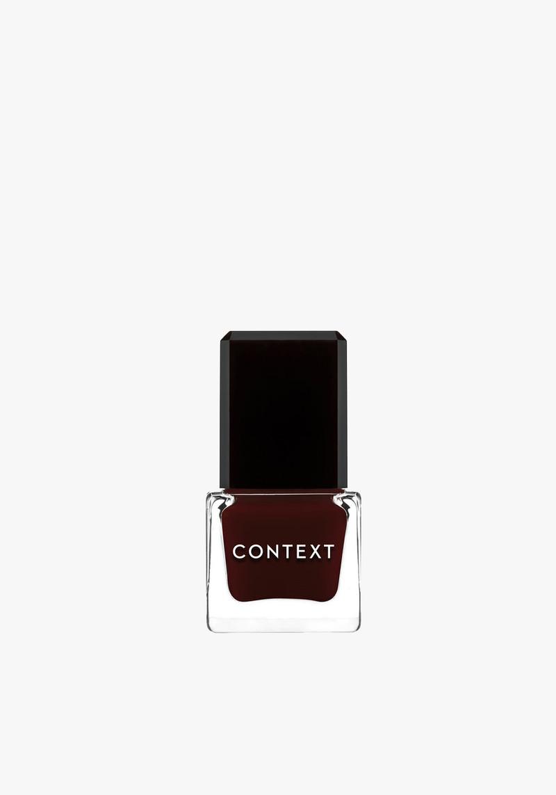 Context skin dark purple nail polish