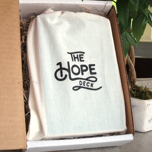 The Hope Deck comes with a bag that holds all the cards and a stand for presenting.