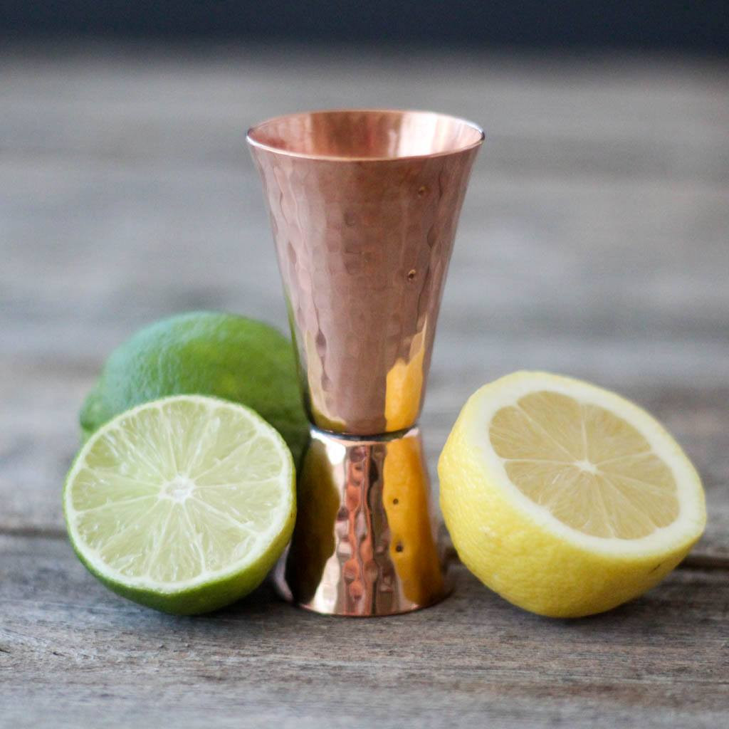 Double Sided Fluted Copper Jigger by Sertodo Copper with lemons and limes