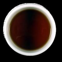 Dehong Ye Sheng Raw Puerh Mini Cake brew from The Jasmine Pearl Tea Co.
