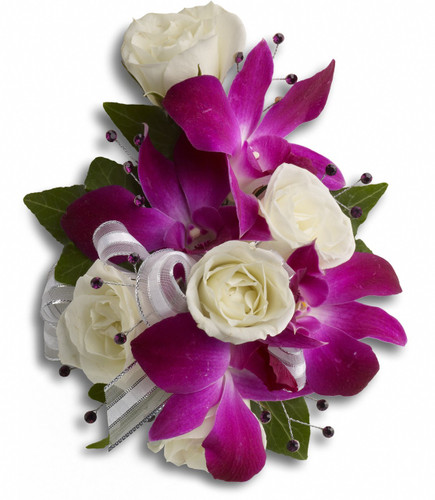 """A fantastic contrast of purple dendrobium orchids with white spray roses on a snap wristlet. Approximately 5"""" W x 6 1/4"""" H"""
