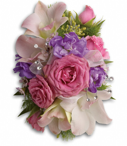"""Pink dendrobium orchids and spray roses, with hints of purple stock, pink waxflower, ming fern and seeded eucalyptus on a snap bracelet. Approximately 4"""" W x 5 1/2"""" H"""