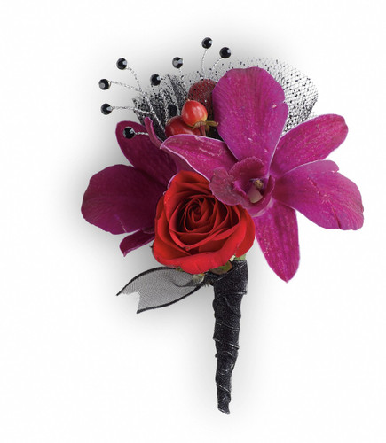 """Purple dendrobium orchids, red spray roses and red hypericum with black rhinestone accents. Approximately 2 1/2"""" W x 4"""" H"""
