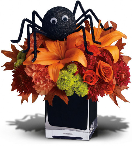 Orange spray roses, asiatic lilies and carnations, green buttons, chrysanthemums, oak laeves and the not-so-itsy-bitsy-spider are arranged and delivered in a modern black cube. Spooktacular!