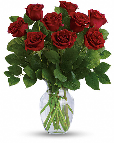 """Romancing the rose! Nothing says """"I love you"""" like a dramatic bouquet of ravishing long stemmed red roses, enveloped in a lush backdrop of fresh lemon leaves. Delivered in a classically graceful vase, it's an unforgettable romantic gesture. This classic bouquet features radiant long stemmed red roses accented with lemon leaf. Delivered in a clear glass vase."""