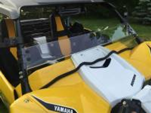 """Yamaha YXZ Hard Coated Polycarbonate Half Shield/ Wind Deflector  Fits: 2016 Yamaha YXZ1000R If you need a full windshield see P/N: 13190  Made from 3/16"""" Thick Hard Coated Polycarbonate. Will not easily crack like cheaper acrylic windshields. Attaches with Rubber Fast Straps. Can be removed in seconds. Contoured to hood with full length rubber seal Made In Cleveland Ohio by EMP®-Logo in part. This is CNC routered from 3/16"""" Thick Hard Coated Polycarbonate making it very durable. A half shield is a great alternative to a full windshield. It allows for airflow keeping you cool and is low enough you can see over it when it gets dirty. It can easily be removed without any tools. Simply, unhook the rubber mounting straps. The bottom edge trim seals and protects your hood.  We reserve the right to make modifications/improvements to our products at any time. Vehicles may have changes throughout the year. Therefore, pictures are a representation of the product you will be getting but may vary due to product revisions."""