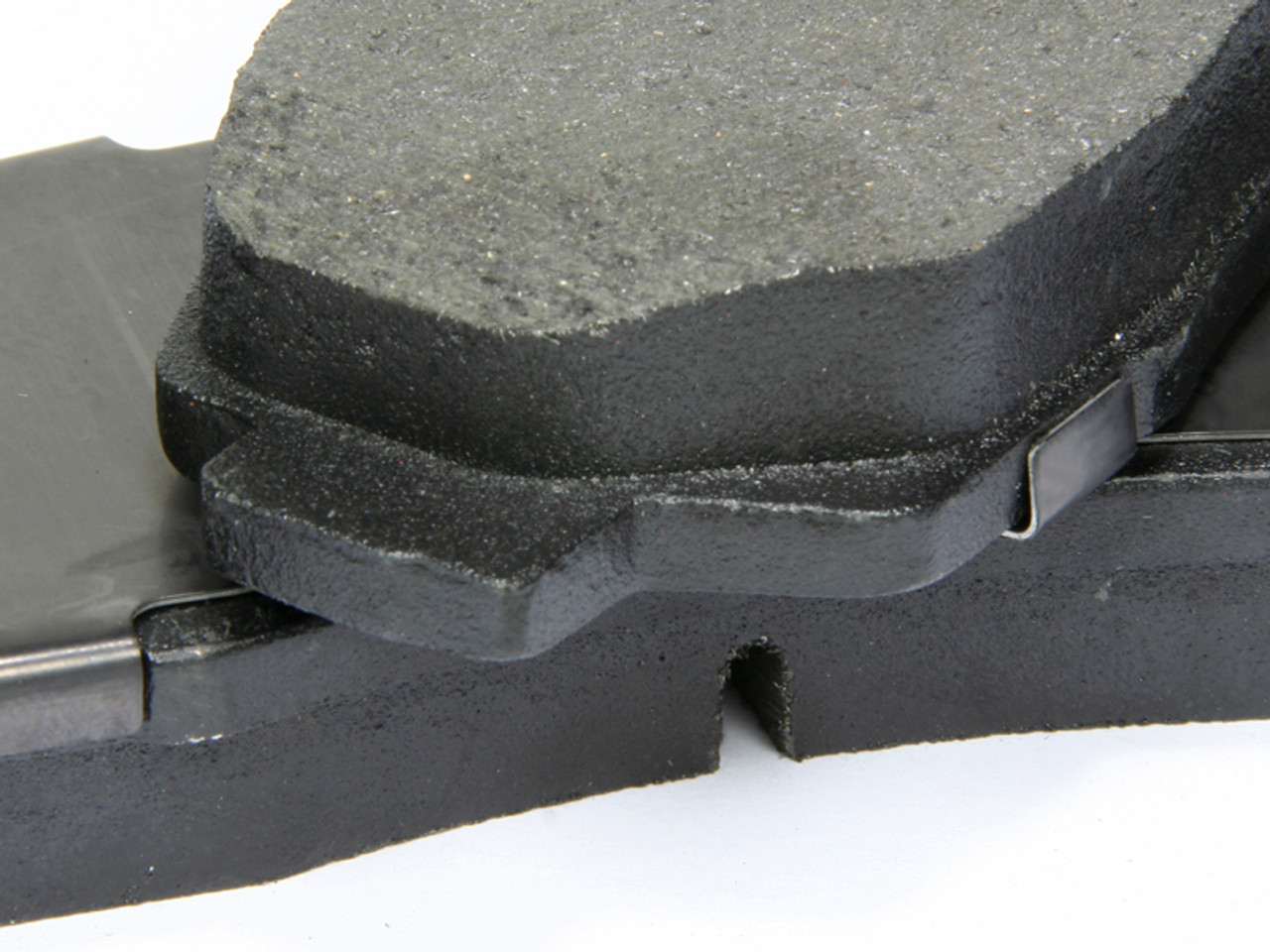 Correct fit of the brake pad in the caliper also works to prevent vibration and noise. Premium Brake Pads have precision cut or shaved backing plates ensuring proper fit in the caliper body.