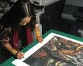 Erin Yoshi signing her Sugar Press Edition of Light in My Eye.