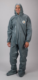 Lakeland FR Chemical Pyrolon CRFR Attached Boots Coverall - Front View of a man wearing a Lakeland Pyrolon Dark gray shiny disposable collared coverall with attached elastic hood, shoe covers, and elastic wrists