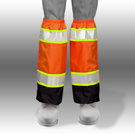 ML Kishigo 3934 ANSI Waterproof Zipper Storm Flap Gaiters - Front View of Orange Hi-Viz Leg Gaiters on a persons legs with silver on yellow reflective stripes on the upper and lower ends. Gaiters go from the ankles to the knees and the lower quarter is black. Elastic at the knees.