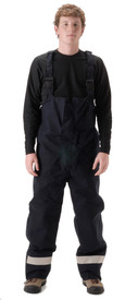 Nasco Oil & Gas CAT 2 Navy Rain Bib Overall - Front View of Young Man wearing a NASCO Navy rain bib overalls with reflective tape round the ankles of both legs