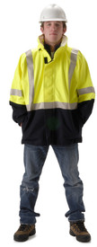 Nasco Yellow Omega FR Waist Length Rain Jacket - Yong guy wearing a NASCO yellow top and black bottom rain jacket with reflective tape around the arms, waist and over the shoulders