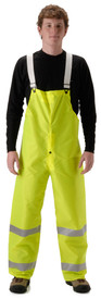 NASCO Class E Hi Visibility Bib Overall - Young Man wearing a NASCO yellow rain bib overall with 2 reflective tape around each leg below the knee