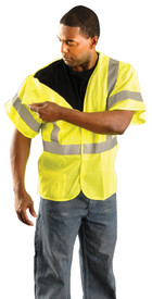 Occunomix Class 3 Mesh 5 Point Breakaway Safety Vest - Front view of man wearing Occunomix yellow high visibility solid safety vest with sleeves, hook & loop front closure, silver reflective horizontal tape around waist and both sleeves and silver reflective tape up both front sides and over shoulders and right vest shoulder pulled away from back showing the Break-Away vest.
