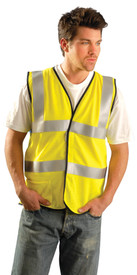 Occunomix Class 2 FR CAT 1 Mesh 2 Stripe Safety Vest - Man wearing Occunomix High visibility yellow mesh vest with hook & loop closure, 1 lower outside right pocket and 2 silver reflective tape placed horizontal around vest under arms and at waist and silver reflective tape going up the front and over both shoulders.